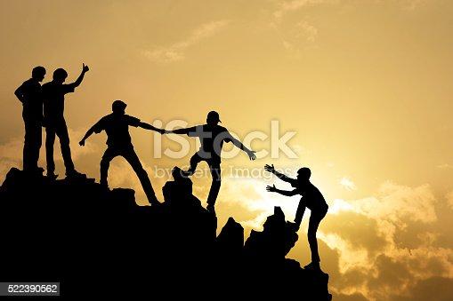istock Group of people on peak mountain 522390562