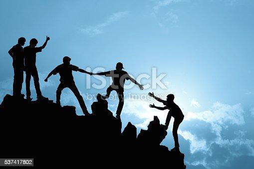 istock Group of people on peak mountain 537417802