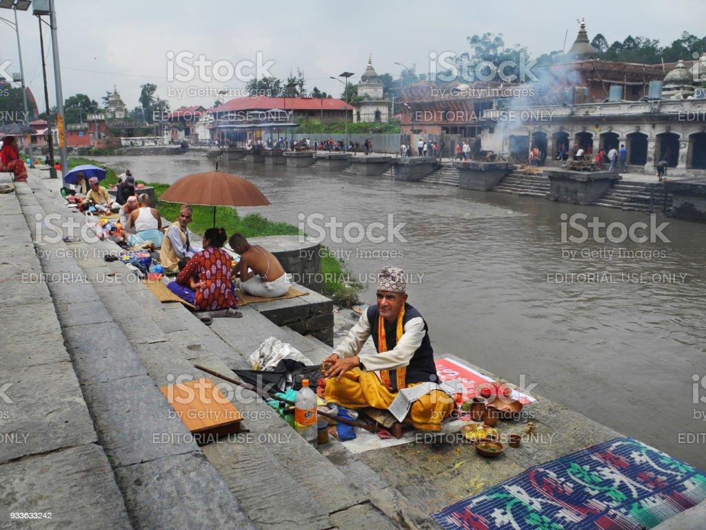 Group of people on religious celebration at Pashupatinath temple Kathmandu stock photo