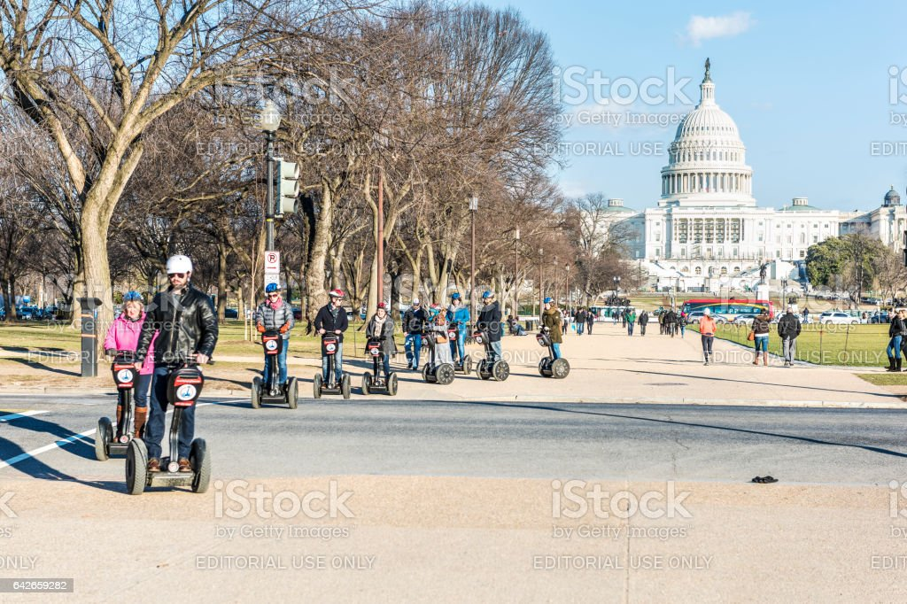 Group of people on segways in front of Capitol congress stock photo