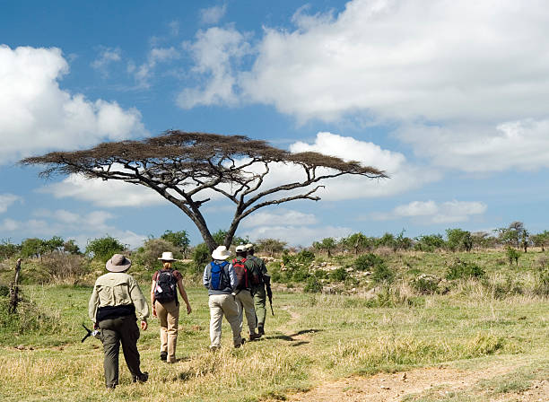 Group of People on Walking Safari in East Africa stock photo