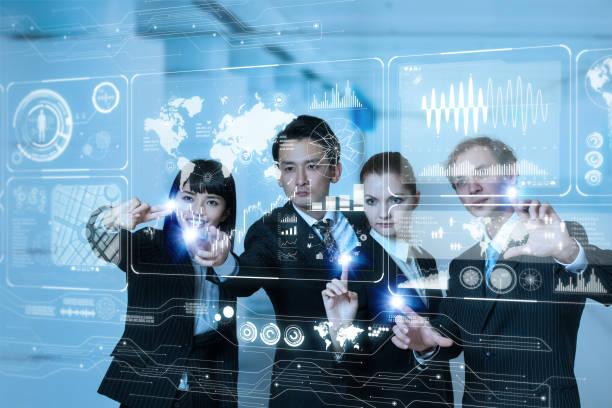 group of people operating futuristic gui. - business woman hologram imagens e fotografias de stock