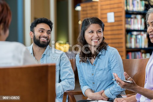 956725740istockphoto Group of people participate in support group 969143820