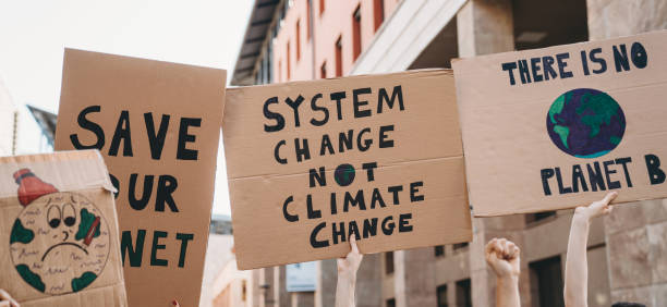 Group of people participating in a protest against global warming stock photo