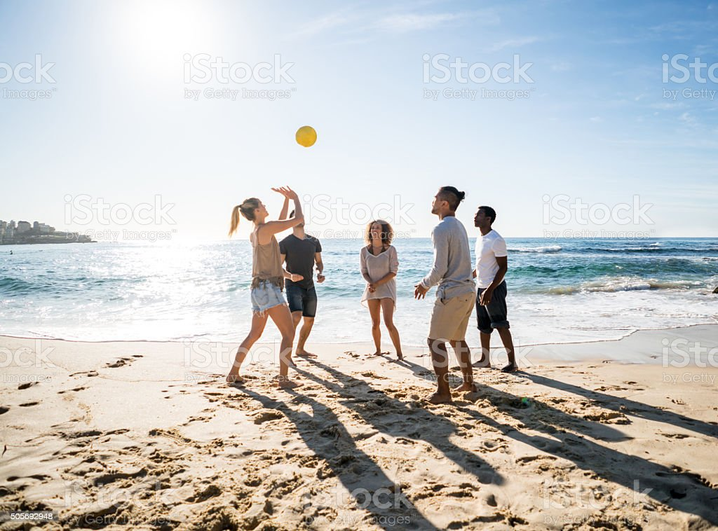 Group of people playing beach volleyball stock photo