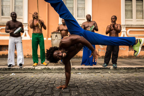 group of people playing capoeira in salvador, bahia, brazil - traditional ceremony stock pictures, royalty-free photos & images