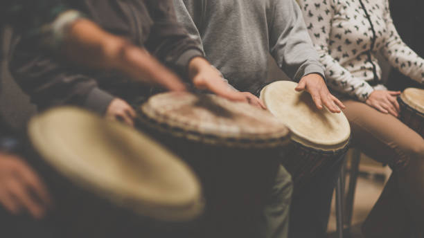 Group of people playing on drums Group of people playing on drums - therapy by music percussion instrument stock pictures, royalty-free photos & images