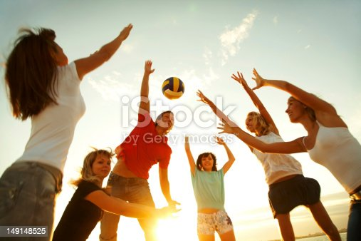 istock A group of people playing volleyball 149148525