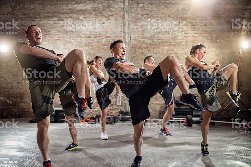group of people practicing kick stock photo