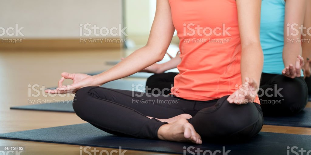 Group of people practicing yoga class, hands closeup background, sport and healthy lifestyle, wellness, well being stock photo