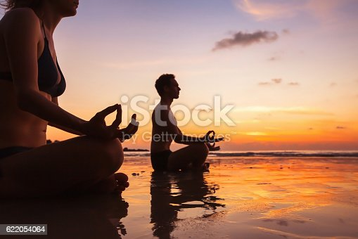 istock group of people practicing yoga 622054064