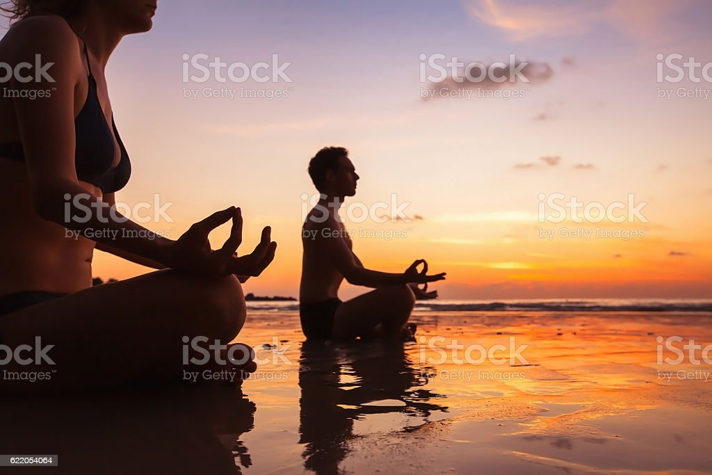 group of people practicing yoga stock photo