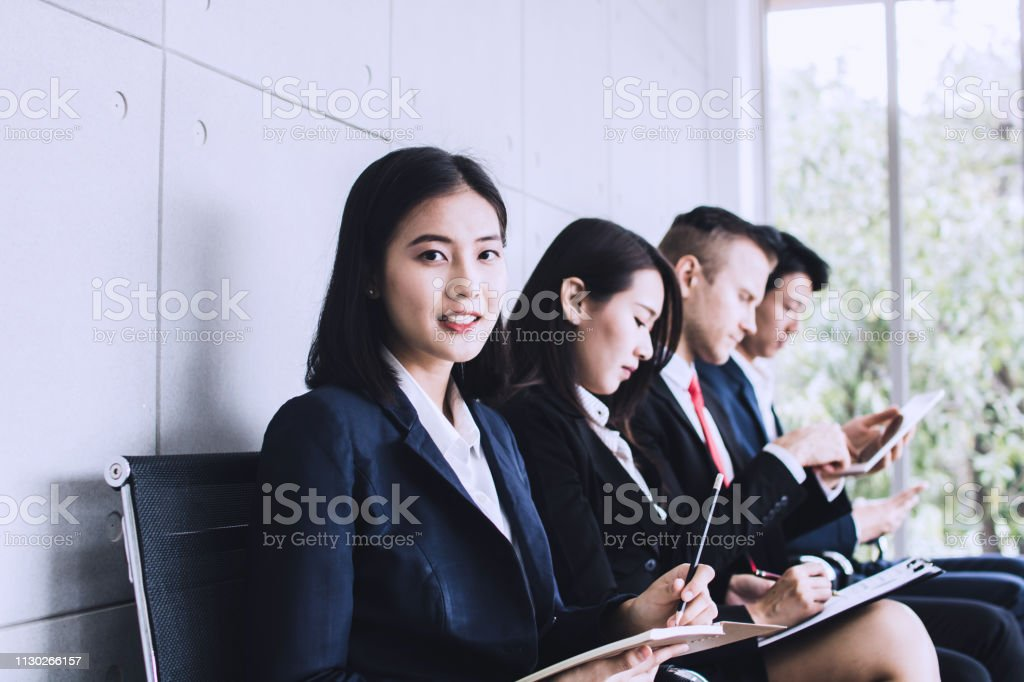 group of people preparing interview and waiting in office