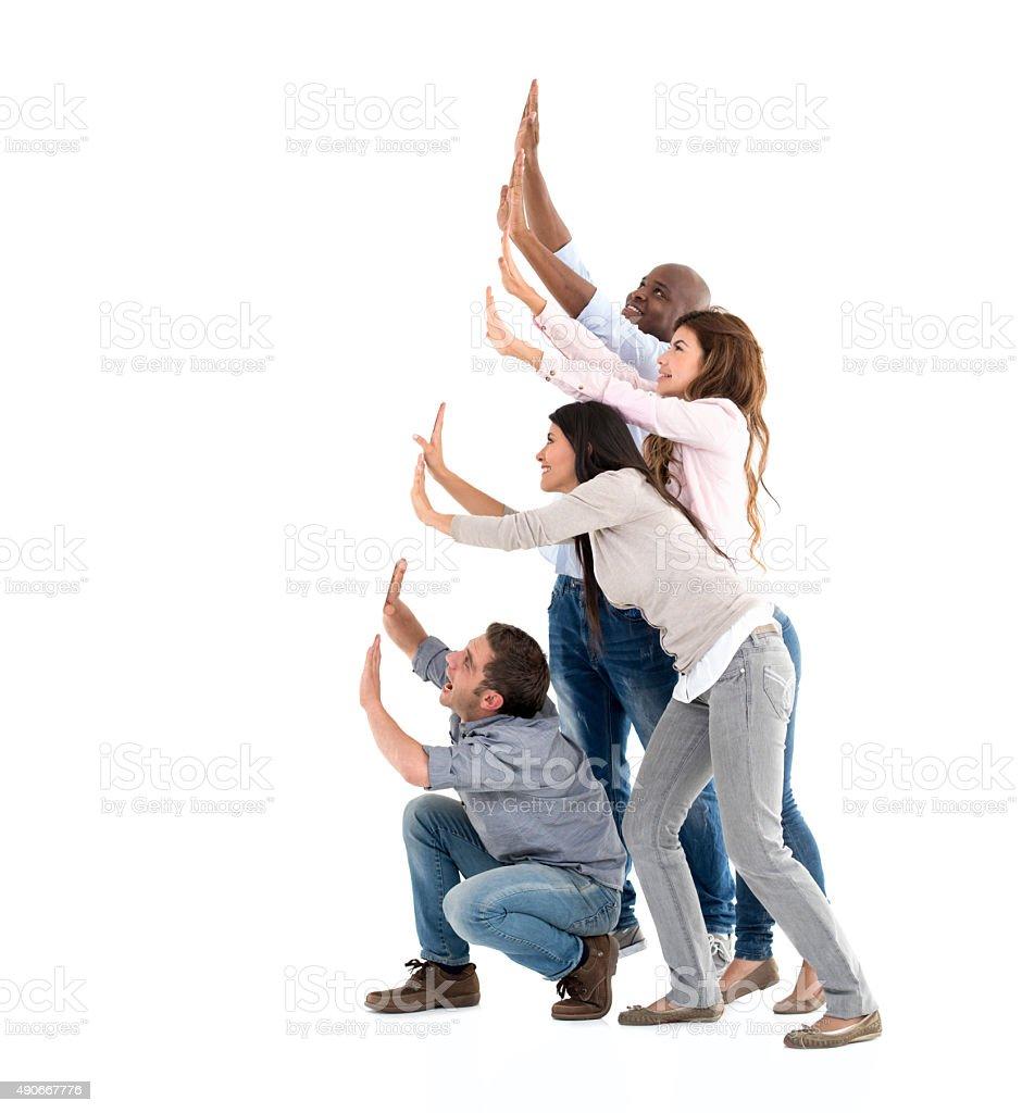 Group of people pushing something stock photo