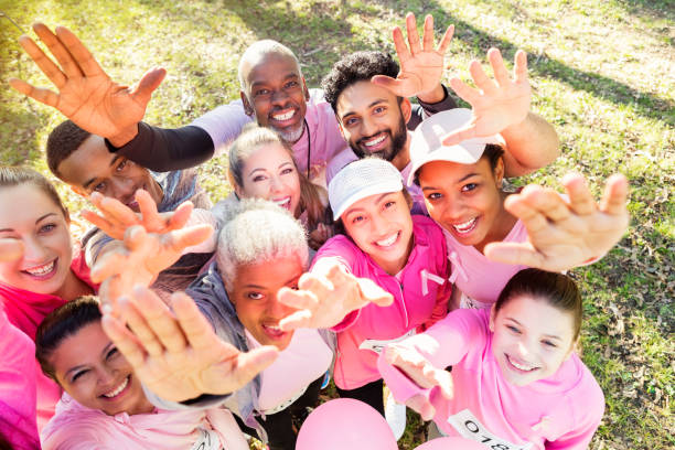 Group of people reaching up during charity event stock photo