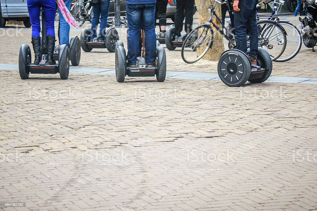 Group of people riding a segway on the city street stock photo