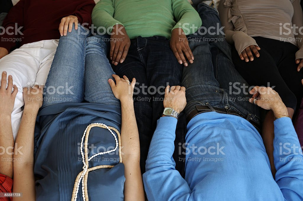 Group of people sharing bed royalty-free stock photo