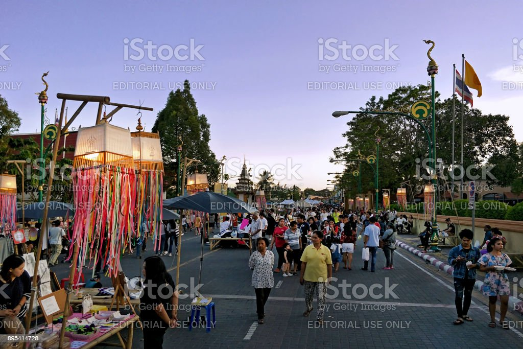 group of people shopping at Local Walking street Market at the front of most famous Wat Phra Mahathat Woramahawihan stock photo