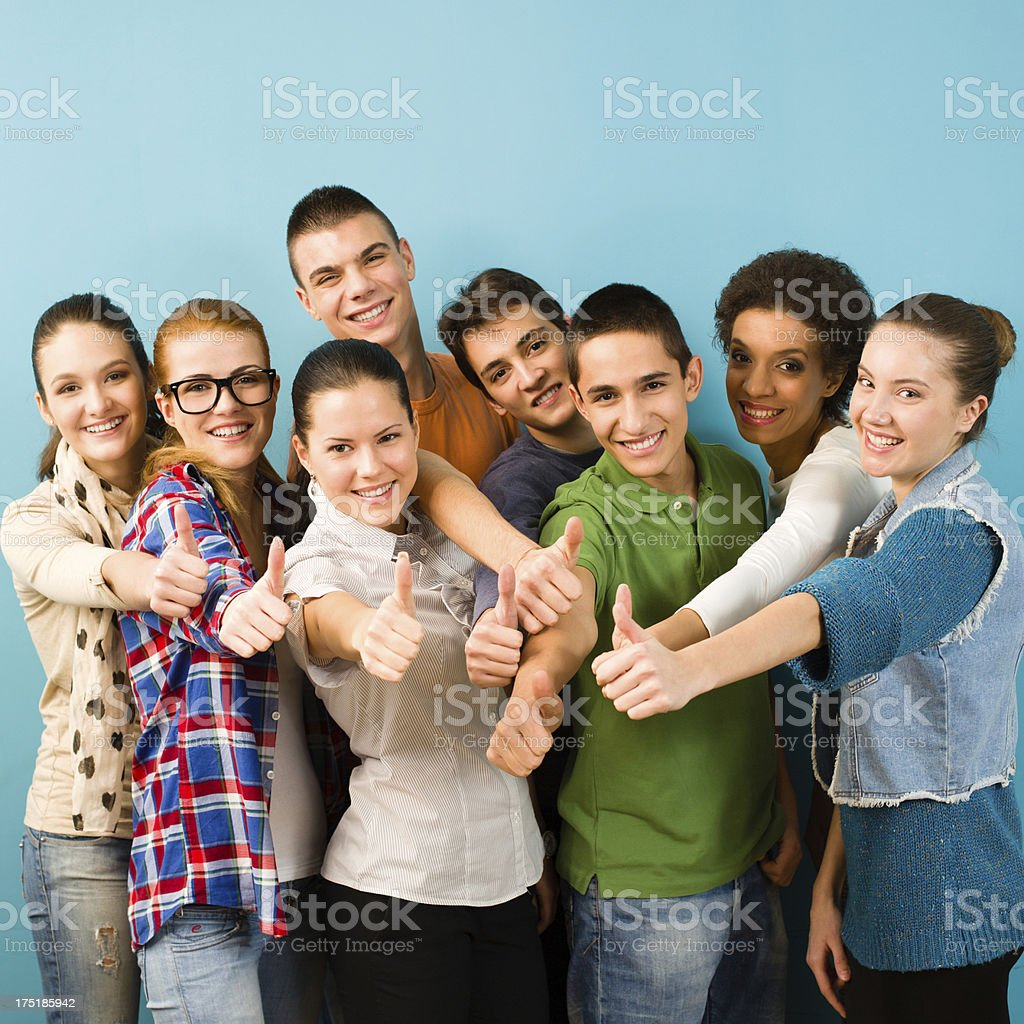 Group of people showing thumbs up stock photo