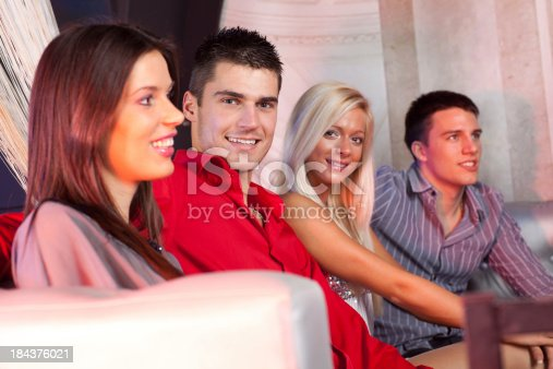 istock Group of people sitting at disco club. 184376021
