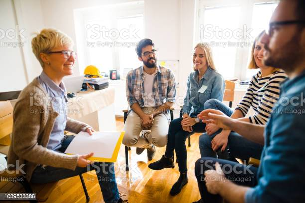 Group of people sitting in a circle on group therapy looking at their picture id1039533386?b=1&k=6&m=1039533386&s=612x612&h=lcb156uzcjc90irgxsplhvxvj8hfe kna7jc pqvdh4=