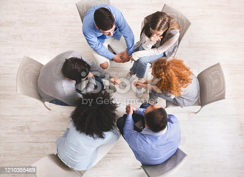 541975802 istock photo Group of people sitting in circle, dicussing problems during therapy session 1210355469