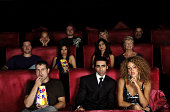 Group of People Sitting in Movie Theatre Cinema