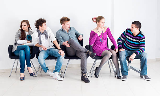 group of people sitting - audition stock photos and pictures