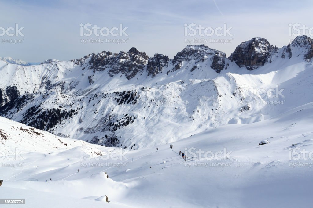 Group of people ski mountaineering and mountain snow panorama in Stubai Alps, Austria stock photo