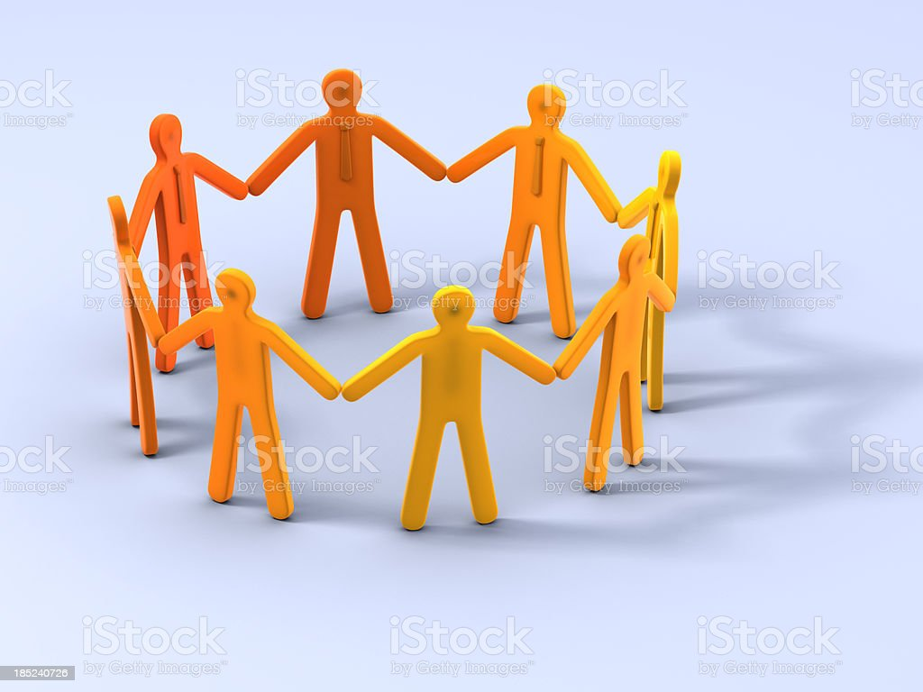 Group of people stand in circle holding hands stock photo