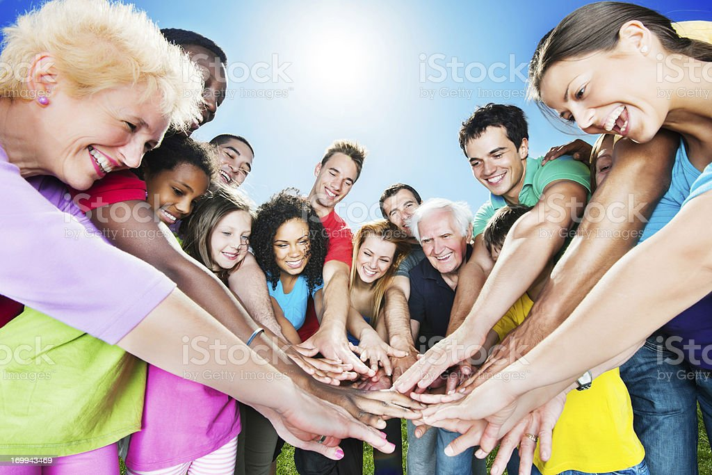 Group of people standing in circle against the blue sky. royalty-free stock photo