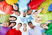 istock Group of people standing in circle against the blue sky. 169974250