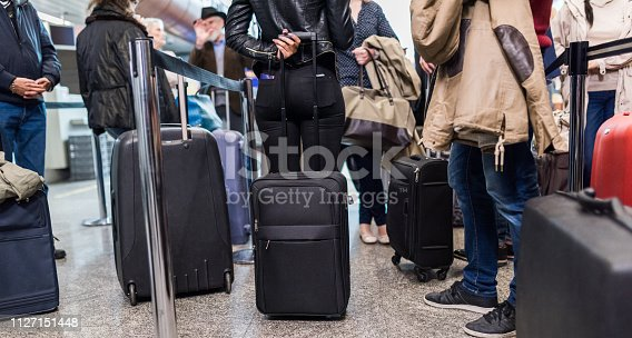 Group Of People Standing In Queue At Boarding Gate