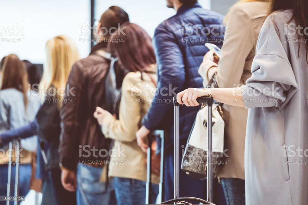 Group of people standing in queue at boarding gate stock photo