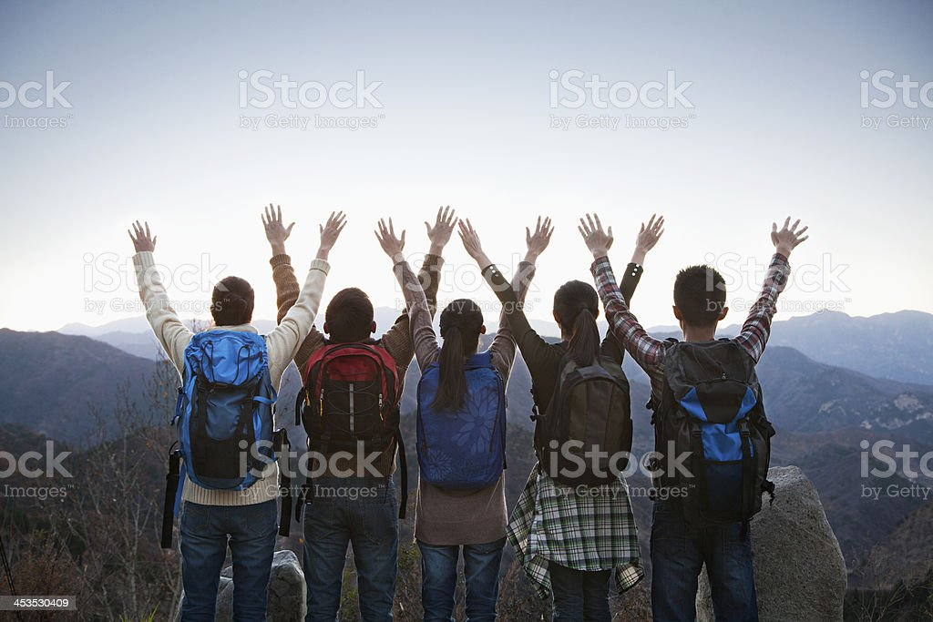 Group of people standing with hands outstretched stock photo