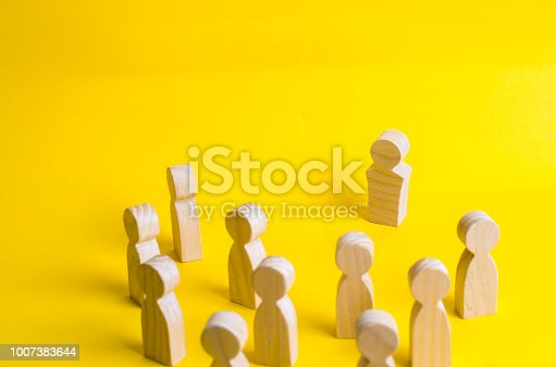 istock A group of people stands and looks at the leader. Business concept of leadership, management. Corporate hierarchy, head of department. Follow the leader. Head of the company. Opposition. 1007383644