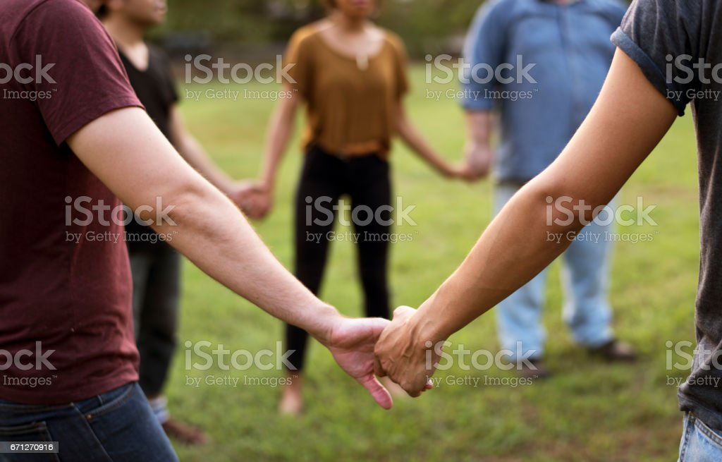 Group of people support unity arm around together stock photo