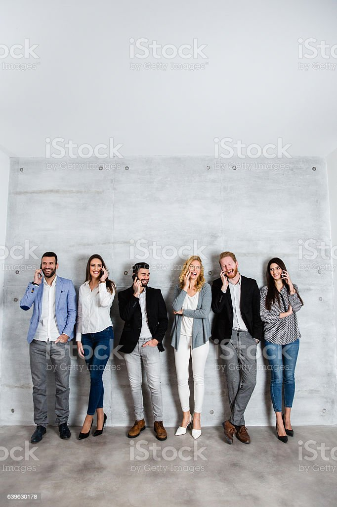 Group of people talking on phone stock photo
