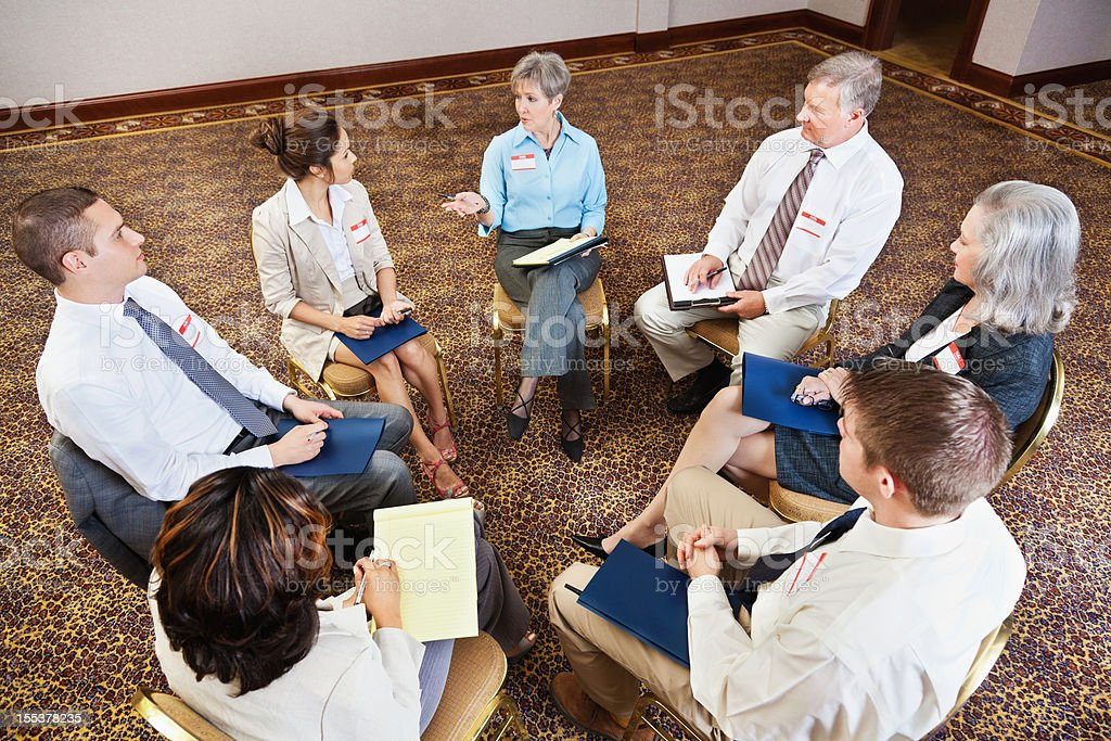 Group of people talking together in a support circle royalty-free stock photo