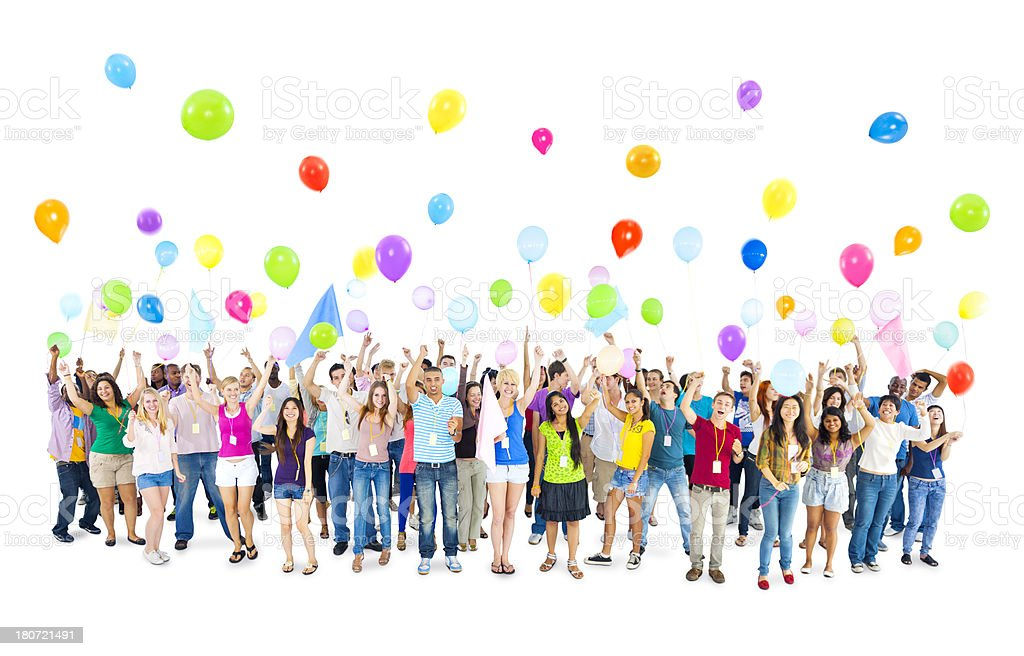 Group of people throwing balloons into air royalty-free stock photo