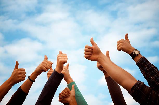 group of people thumbs up blue sky.copy space - voting hands stockfoto's en -beelden