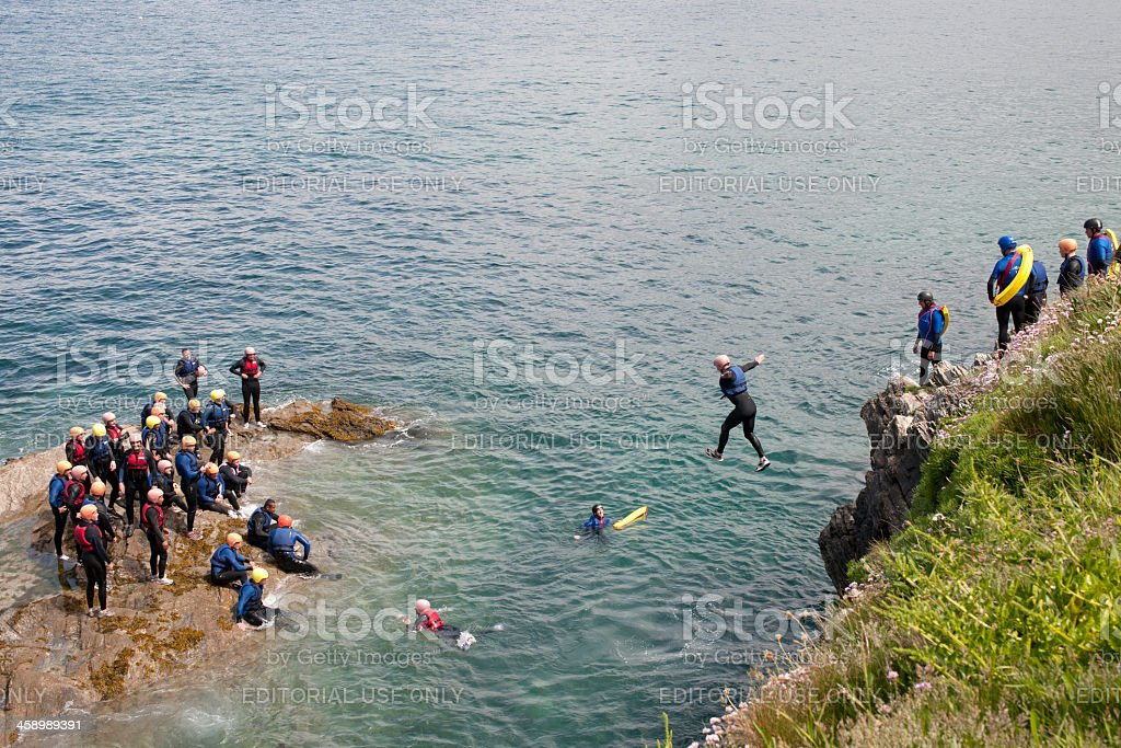 Group of people Tombstoning in Newquay stock photo