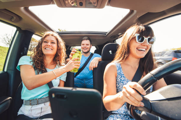 group of people travel by car. stock photo