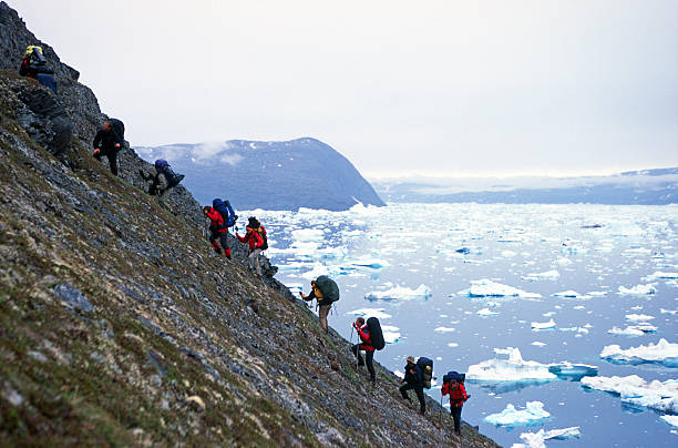 Group of people trekking in Greenland Group of people trekking in Greenland.More images of same photographer in lightbox: steep stock pictures, royalty-free photos & images