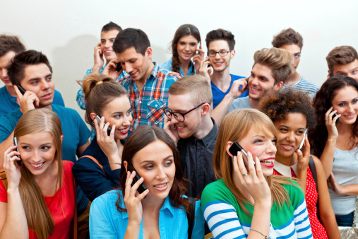 Group Of People Using Mobile Phone Stock Photo - Download Image Now
