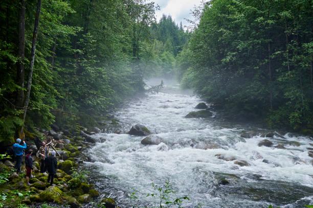 Group of people visiting Lynn Creek River at North Vancouver, British Columbia, Canada stock photo