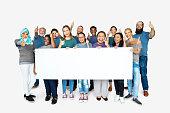 istock Group of people volunteer with empty board advertising 697849394