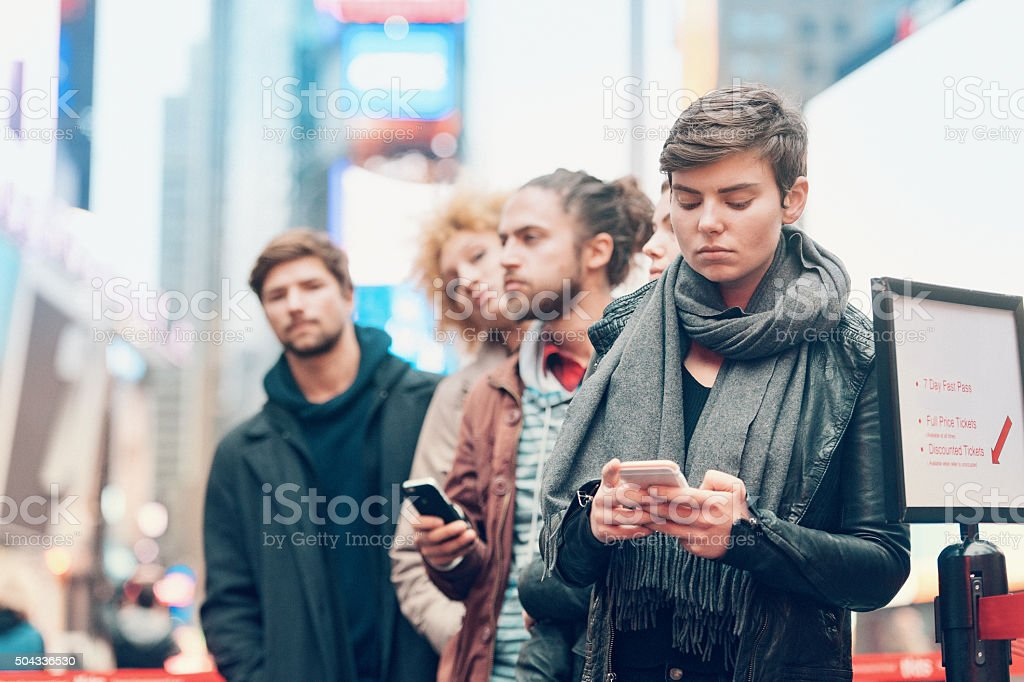 Group of people waiting in line stock photo