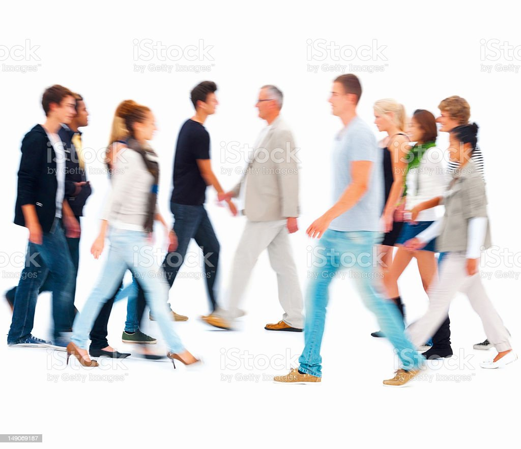 Group of people walking against white background stock photo