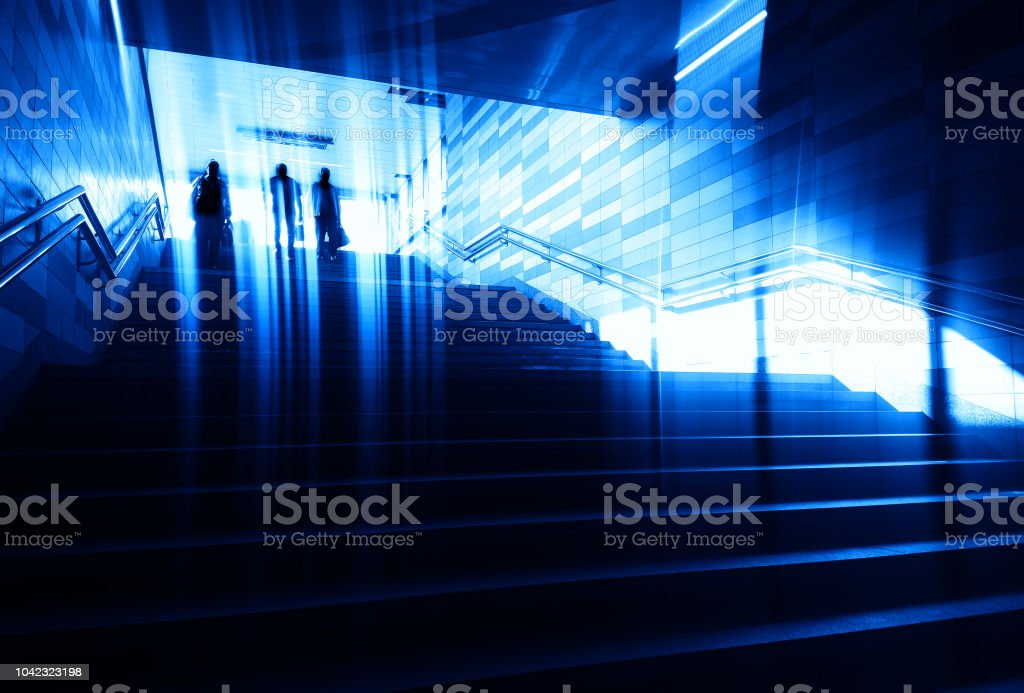 Group of people walking city stairs background stock photo